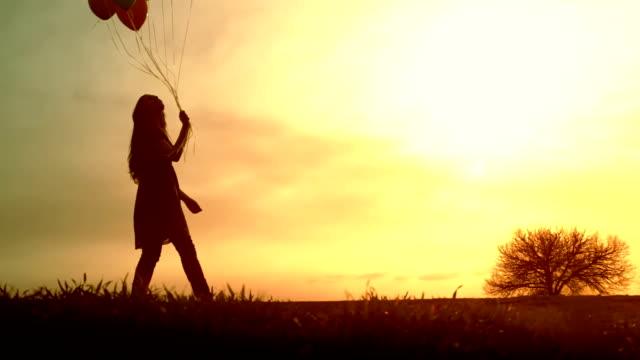 Joyful Young Woman Walking Meadow Balloons Sunset Happy video