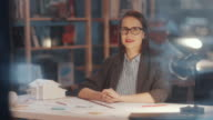 istock Joyous Female Architect Drawing Floor Plan and Smiling at Camera 1252378220