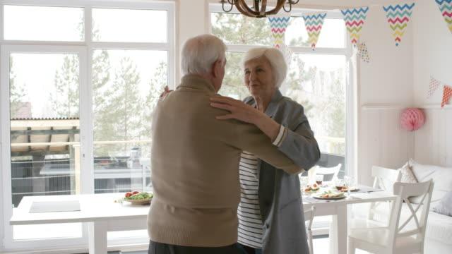 Bидео Joyous Senior Man and Woman Dancing at Party