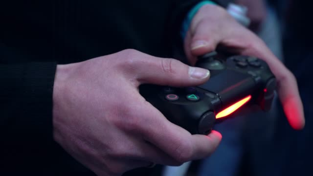 Joystick in the hands of a gamer