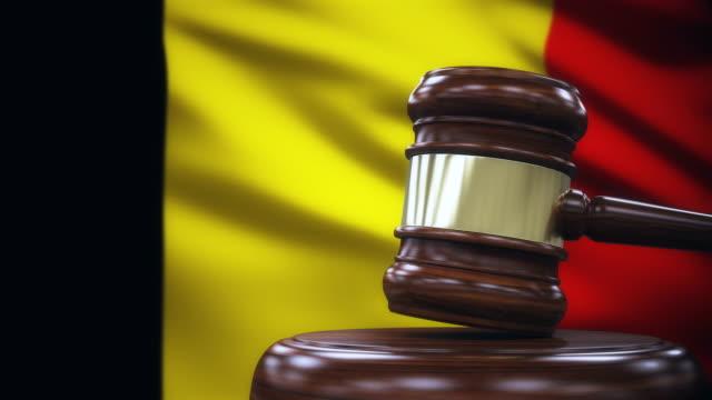 judge gavel with belgium flag background - belgio video stock e b–roll