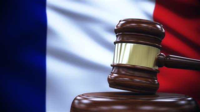 judge gavel with france flag background - sistema legale video stock e b–roll