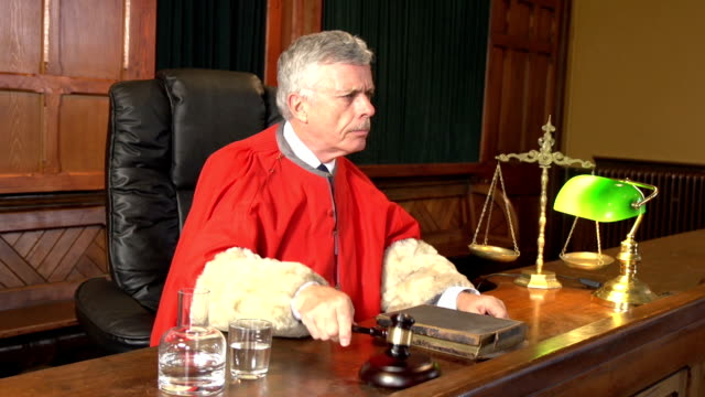 Judge in Court, Red Robe using Gavel, Two Shots (Courtroom) Stock HD video clip footage of a Judge in a Courtroom wearing a red robe using his gavel to call order - Two Shots, a close up shot and a wider Crane shot sentencing stock videos & royalty-free footage