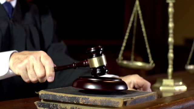 Judge in Court using Gavel - Super Slow Motion video