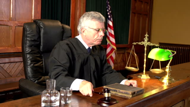 Judge in Court using Gavel - Two Shots USA Flag video
