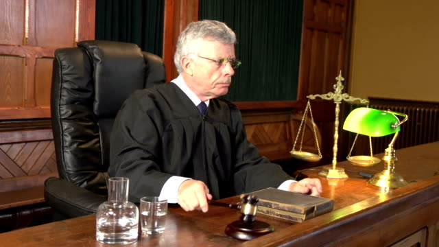 Judge in Court using Gavel (Courthouse) - Two Shots video