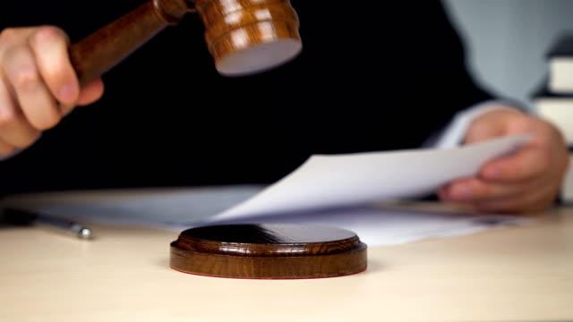 Judge striking gavel, beginning or end of proceeding, attention, hands closeup Judge hitting hammer against hardwood domination stock videos & royalty-free footage