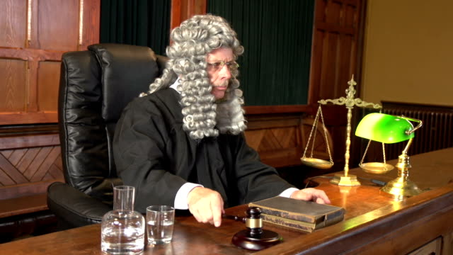 Judge with Wig in Court using Gavel - Two Shots video