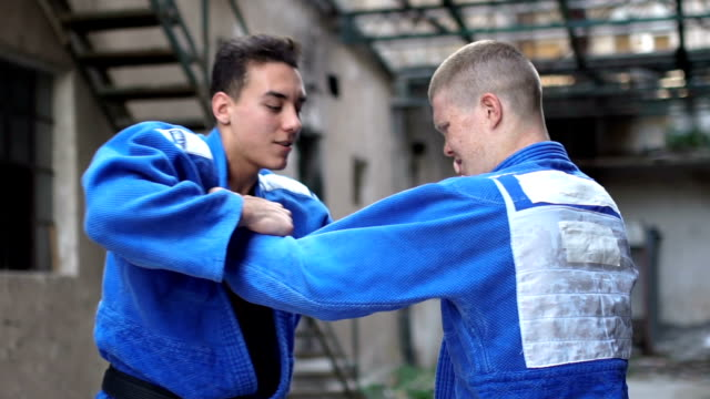 Judo sparring close up in slow motion video