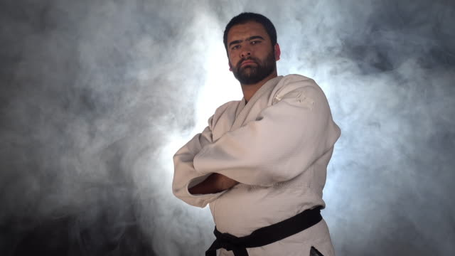 Judokas fighter looking at camera video