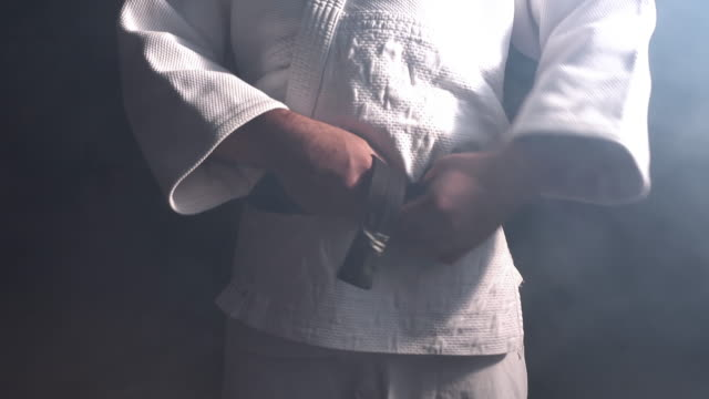 Judokas Fighter tying black belt video