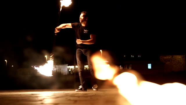 Juggling fire pins in night fire show art performance Juggling fire pins in night fire show art performance pyrotechnic effects stock videos & royalty-free footage