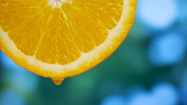 Juice flows from slices orange fruit