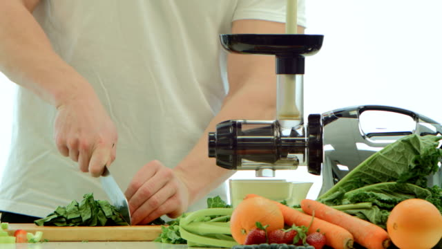Juicing A man making healthy juice using fresh fruits and vegetables celery stock videos & royalty-free footage