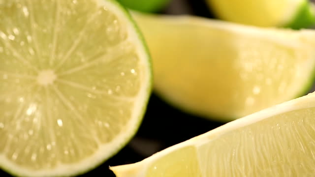 Juicy green lime closeup, citrus fruit rich in sugars and acids, healthy diet video