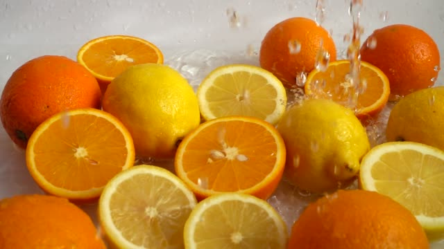 Juicy oranges and lemons and splashes. Slow motion. video