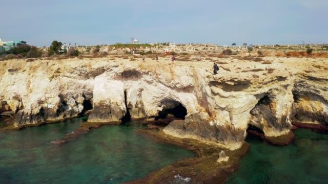july 10, 2018 - limassol, cyprus: beautiful cliffs and arches in aiya napa - geografia fisica video stock e b–roll