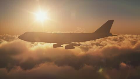 vidéos et rushes de jumbo jet au-dessus des nuages avec soleil - avion