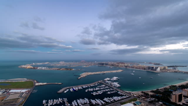 Jumeirah Palm Island night to day timelapse dubai shot from the rooftop top of the tower in dubai marina, uae video