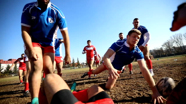 Jump for the win Young and strong rugby team on the field, rough group training. rugby stock videos & royalty-free footage