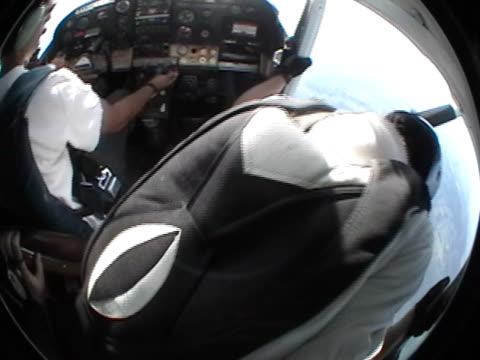jump from an airplane - sky diving plane inside bildbanksvideor och videomaterial från bakom kulisserna