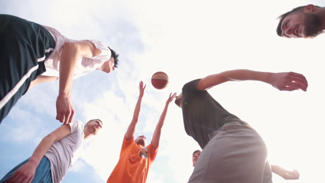 Jumping for the ball Group of young adults playing amateur basketball outdoor practice drill stock videos & royalty-free footage