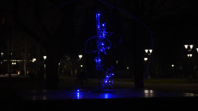 Jumping light bulbs Element of night blue Led lighting, installed in an urban environment. illusion stock videos & royalty-free footage