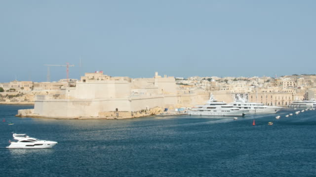 June 2016. Valletta, Malta. Boat floating in capital with beautiful waterfront view video
