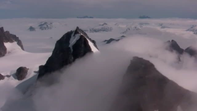 Juneau campo de hielo glaciar Antártida Flying Snow Mountains - vídeo