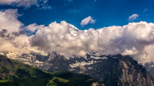 Jungfrau massif Switzerland Alpine landscape summer time lapse video