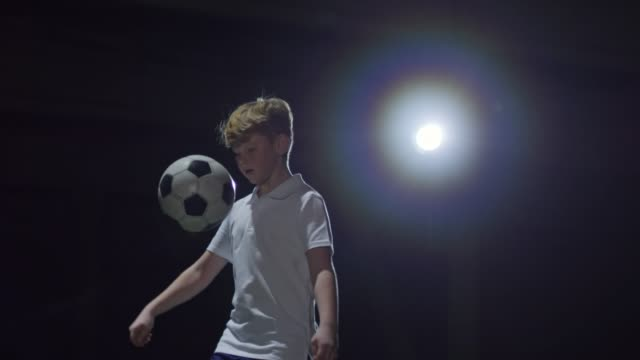 Junior Athlete Juggling Soccer Ball in Indoor Arena video