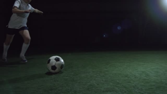 Junior Athlete Shooting a Soccer Ball video