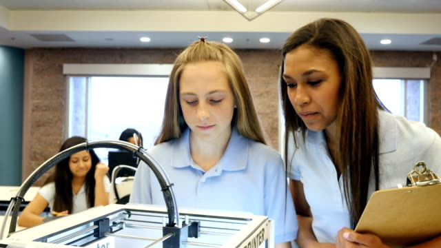 Junior high and High school STEM students watch and record observations as 3D printer prints video