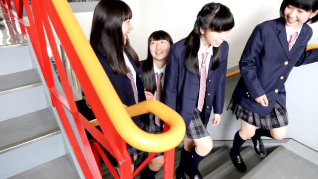 junior high students acting in a group - uniform filmów i materiałów b-roll
