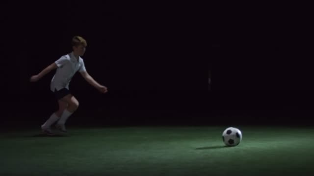 Junior Soccer Player Kicking Ball video