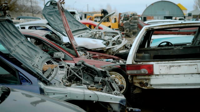 Junk yard with old cars and wreck video