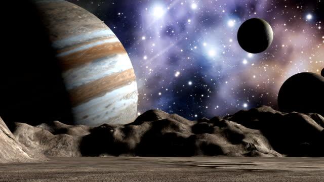 jupiter i moons w przestrzeni krajobrazu - io księżyc filmów i materiałów b-roll