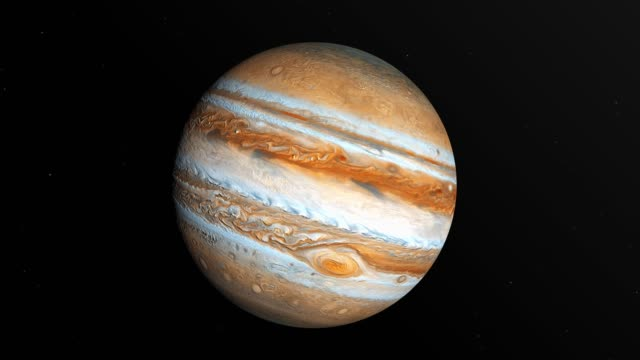 jupiter is spinning in outer space with stars at black background in 4k resolution - jowisz filmów i materiałów b-roll