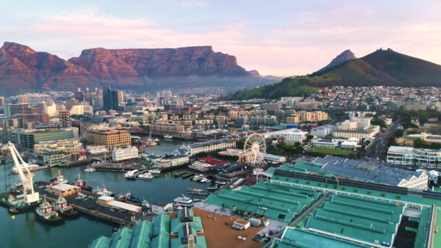 Just another day in Cape Town Aerial shot flying sidewards over the V&A Waterfront harbor in Cape Town western cape province stock videos & royalty-free footage