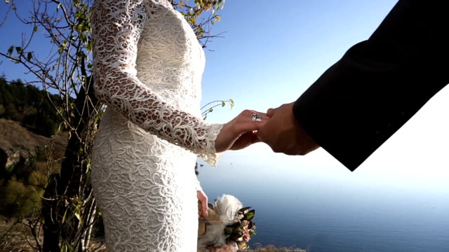 Just married couple holding hands Just married couple holding hands newlywed stock videos & royalty-free footage