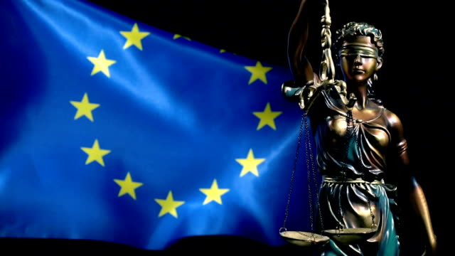 Justice Statue and European Union Flag