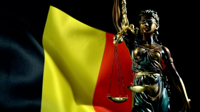 justice statue with belgian flag - belgio video stock e b–roll