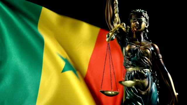 justice statue with senegalese flag - dakar video stock e b–roll