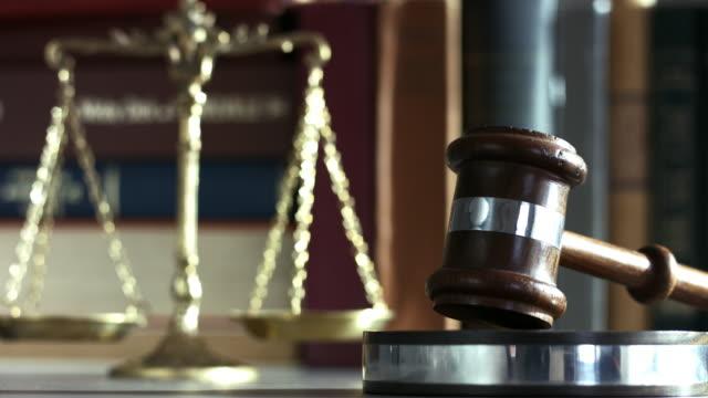 Justice weight with gavel Justice weight with gavel sentencing stock videos & royalty-free footage