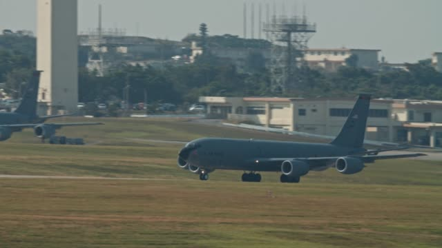 Kadena AB Okinawa Japan Feb 21 2020 Military aircraft taking off and on runway fighter jet, refueler, air tanker, A10, F15,C130 USAF