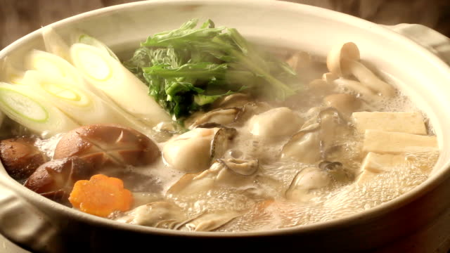 kakinabe Oysters and vegetable stew cooking pan stock videos & royalty-free footage