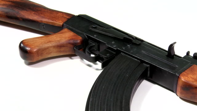 AK 47 Kalashnikov 1947, beauty-shot close-up on white background with a pan-shot from left to right, starting at its wooden stock. video