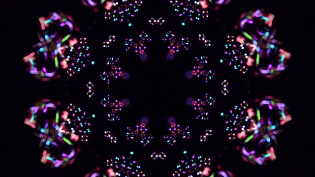 vídeos de stock e filmes b-roll de kaleidoscope abstract background. soft colours on black background - mandala