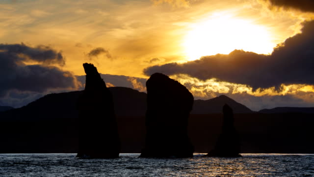 Kamchatka Peninsula seascape: Three Brothers Rocks in Avacha Bay (Pacific Ocean) at sunset video