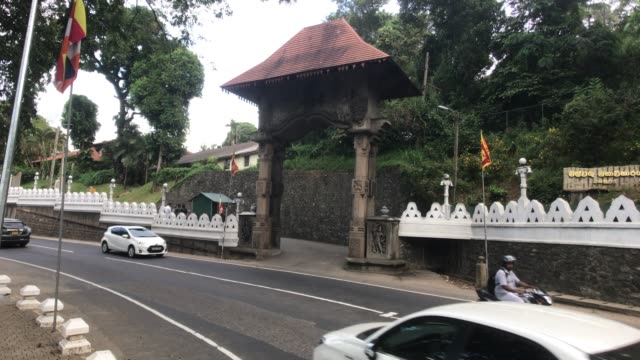 Kandy, Sri Lanka, traffic on the street near the entrance to the temple Kandy, Sri Lanka, traffic on the street near the entrance to the temple 4K sri lankan culture stock videos & royalty-free footage